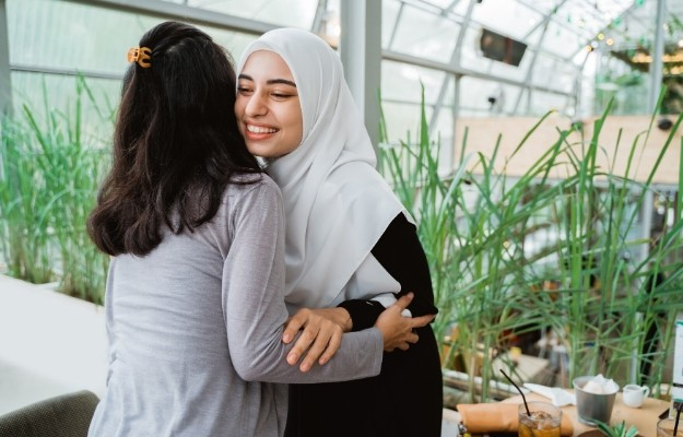 2 women hugging and smiling with each other | take time | How To Apologize In A Genuine Way