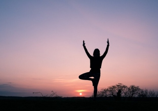 A person balancing on one leg in dawn scene | Imagine Long-Term Effects of Your Options | How To Do A Home Makeover On A Budget