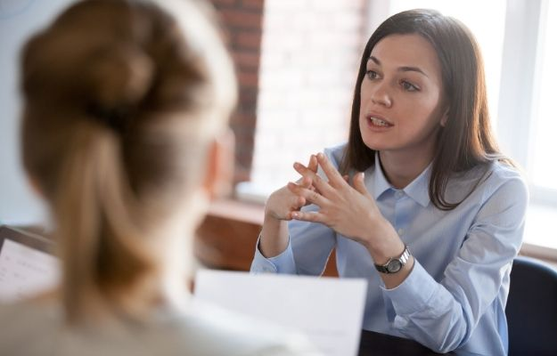 Middle-aged couple talking and solving problems during group assertiveness training | Feature | Assertiveness Training: How to Be More Assertive and Stand Up For Yourself