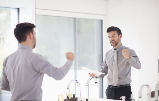 Mid adult businessman practicing presentation in mirror | Practice | The Art Of Public Speaking: How The Pros Do It
