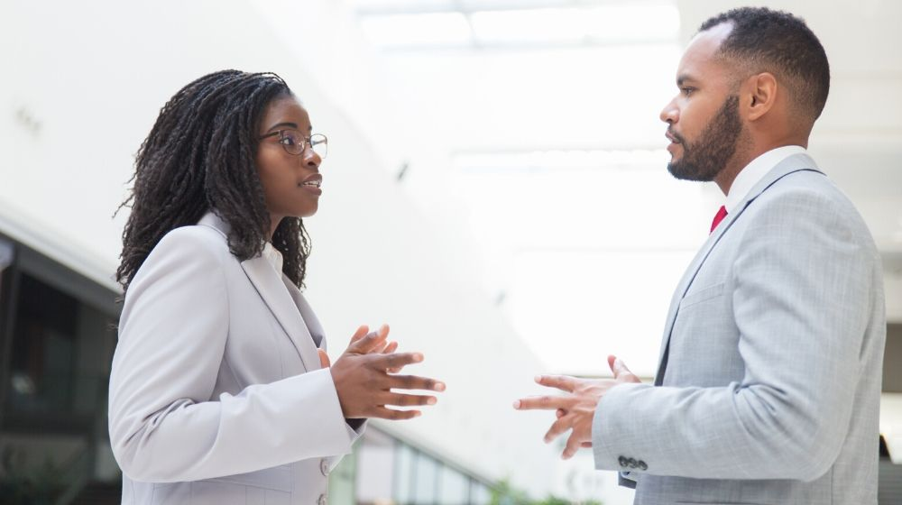 Two business people arguing in work place | Feature | Arguing Well - 12 Tips from Lawyers