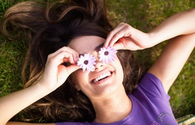 a happy and cheerful women is lying on grass | Be greatful | How To Be The Best Version Of Yourself