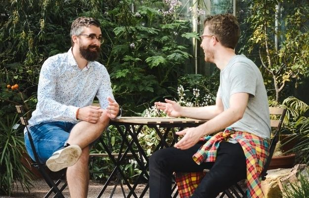 2 men having conversation and having eye contact | Establish Proper Eye Contact | How to Be a Soothing Presence: 11 Tips