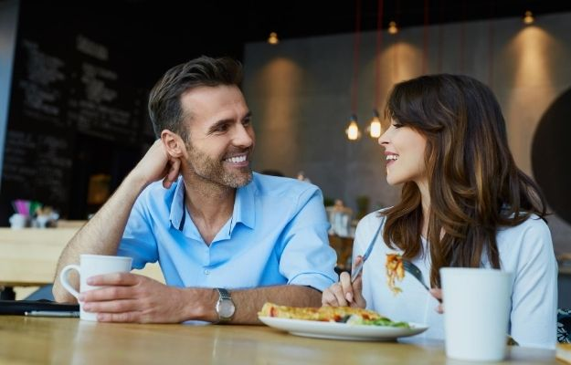 a couple is chatting and having eyes contact with food on the table | Master Eye Contact | How to Be Sexy Without Realizing It: Guys Edition