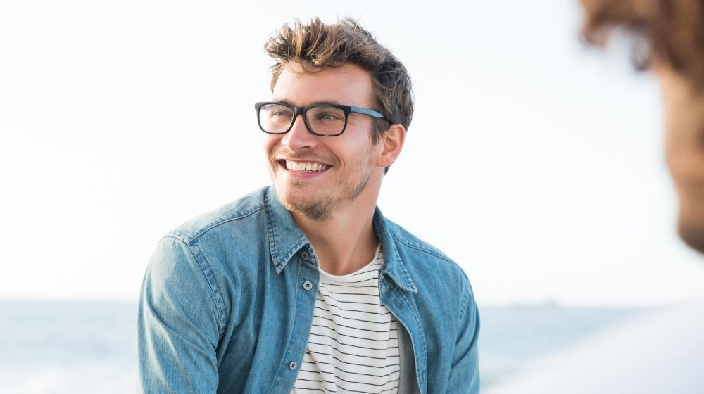 a good looking man wearing glasses and smiling | Feature | How to Be Sexy Without Realizing It: Guys Edition
