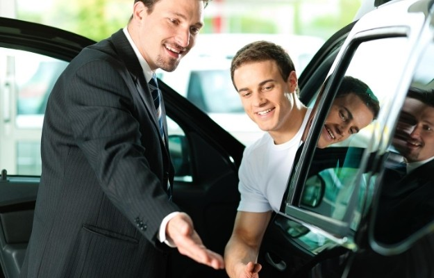 a salesperson introducing a brand new car to his customer | Persuasion is Not a Dark Art | How to Persuade People: 9 Tips from Salespeople