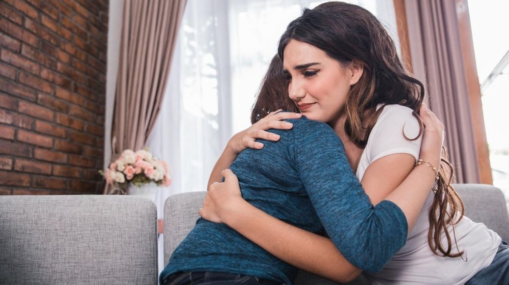 a woman hugging her mom with empathy   Feature   How to Be More Empathetic: 10 Ways