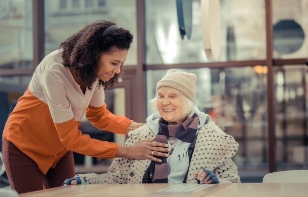 a woman is taking care for an old woman | Be Confident But Avoid Overconfidence | 6 Tips to Become A Real Altruist