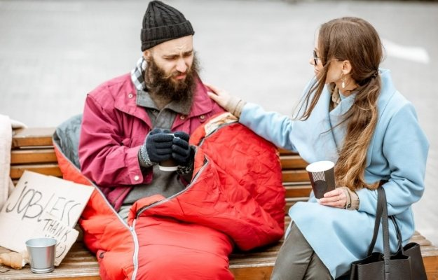 a woman is talking to a homeless man | Give What You Can | 6 Tips to Become A Real Altruist