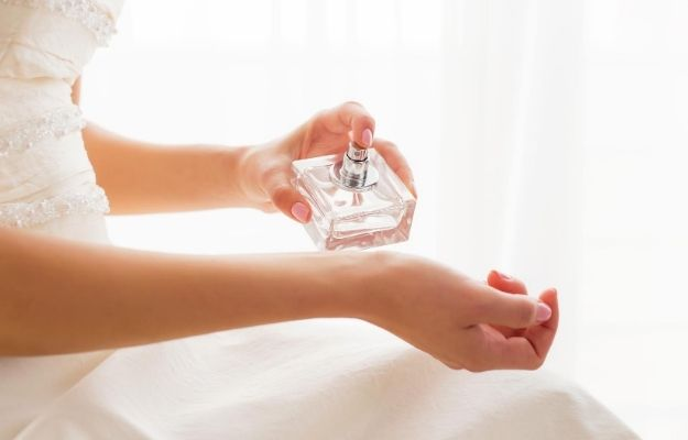 a women wearing white dress is using perfume | Wear Perfume | How to Be Sexy Without Realizing It: Girls Edition