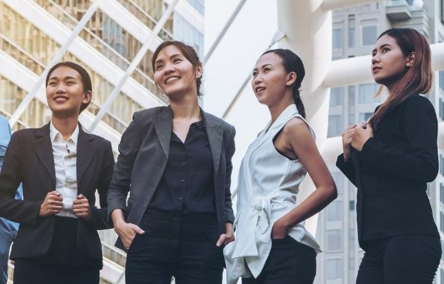 four elegant office women are confidently posing | be confident | How to Be Sexy Without Realizing It: Girls Edition