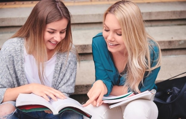 two girls are studying together | Pick the Right Friends |15 Things You Can Do To Be A Better Student
