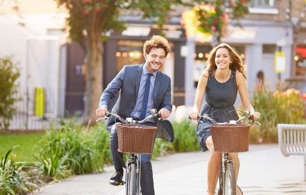 two people are riding bicycles | Physical Fitness | How Sustainable Living Can Lead to Your Best Life