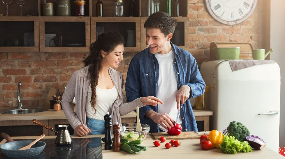 2 people cooking in the kitchen | Feature | Cooking Basics You Can Master to Be A Better Cook