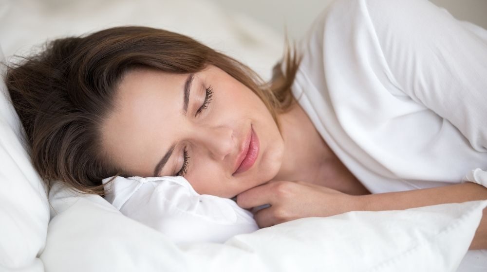 A girl having a good sleep | Feature | How to Have Better Dreams At Night