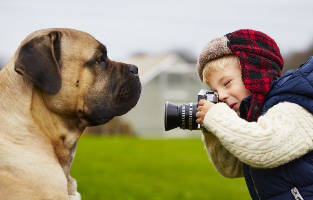 Little boy with camera is shooting his dog | Into The Woof Woof World | Be a Better Pet Photographer