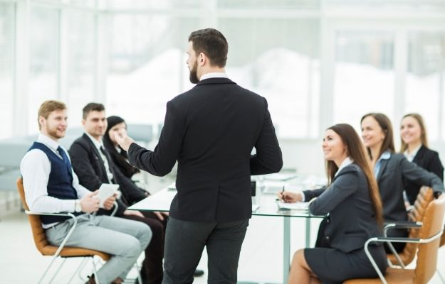 a businessman is giving a speech at the meeting   How To Make Your Voice Deeper   It Leads to Success