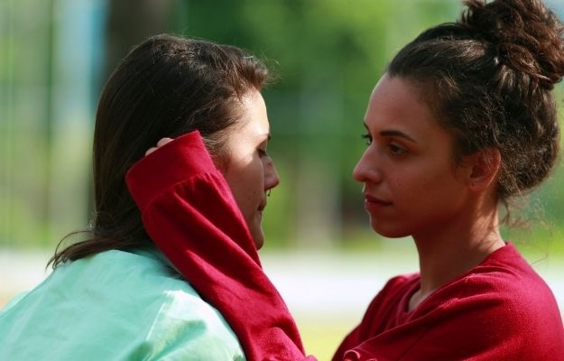a girl is sad and her friend encourages her by touching her face | Be Empathetic | 6 Easy Ways To Make People Admire You More