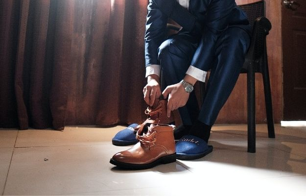 a guy wearing suit combined with boots   Dress for Success: What to Wear?   How to Dress for Success in Any Situation