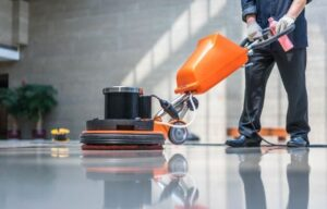 a man is cleaning floor with cleaning machine | Entrepreneur Ideas To Start A Business | Cleaning Business