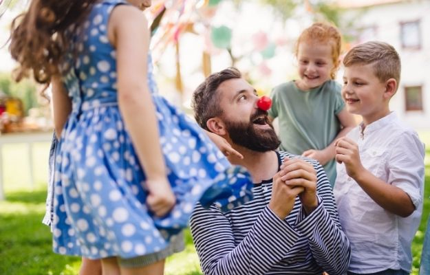 a man wearing clown nose and having fun with kids | Do Interesting Things | 10 Ways To Become The Cool Aunt or Uncle