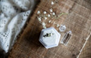 a ring is put on box with decoration of a crystal beside | Entrepreneur Ideas To Start A Business | Jewelry Making
