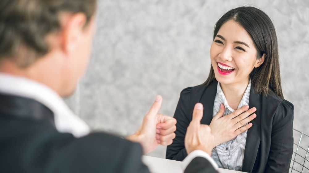 business man employer admires young Asian business woman | Feature | 6 Easy Ways To Make People Admire You More