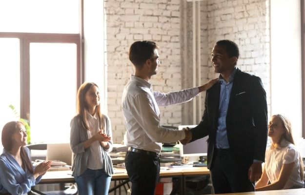 Boss thanking employee for doing good work-ca   Leader vs Boss: How To Be Great At Both   Qualities of a Good Boss