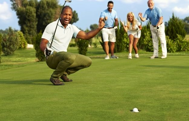 Male golfer and his partners feeling cheerful when putting in golf ball on the green | How to Be Better At Golf: 5 Easy Ways | Identify and Keep Track of Your Weaknesses