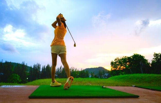 woman driving practice golf training for a better hit in course | How to Be Better At Golf: 5 Easy Ways | Have The Right Posture
