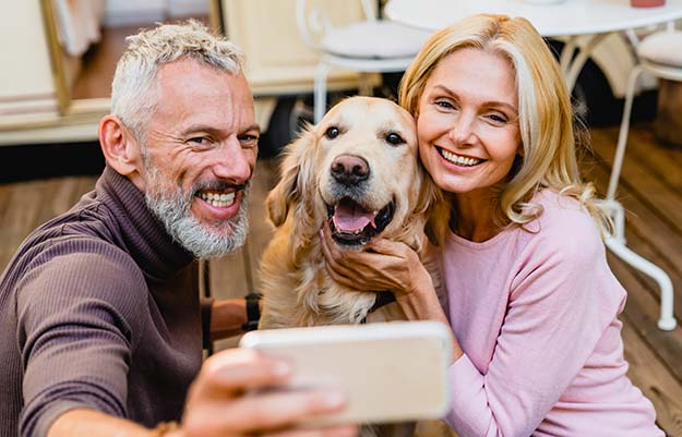 Elder couple taking selfies with family dog | 9 Steps On How To Look And Feel Younger | Get a Pet