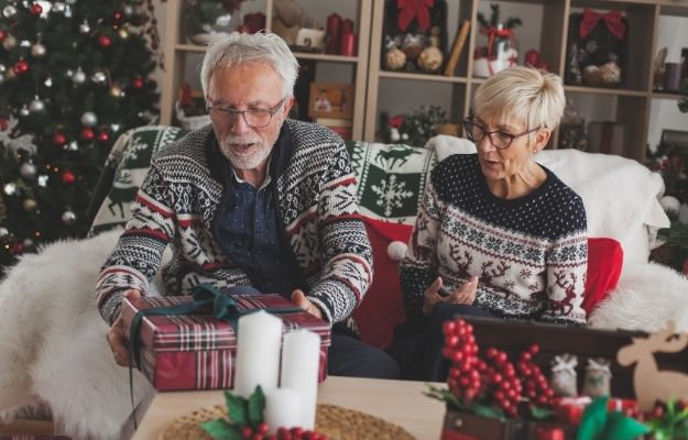 an old couple is unboxing gift - ca | Christmas Party Games That Will Keep You Entertained For Hours | Secret Santa