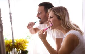 couple brush teeth toghther-ca.| How To Get Rid of Bad Breath | Brush Twice A Day