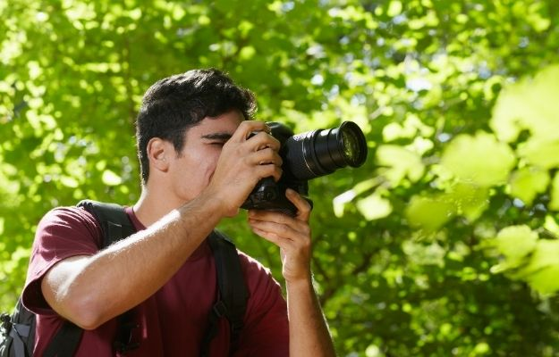 a man is taking pictures with dslr camera | Photography | Top 8 Useful Skills To Learn