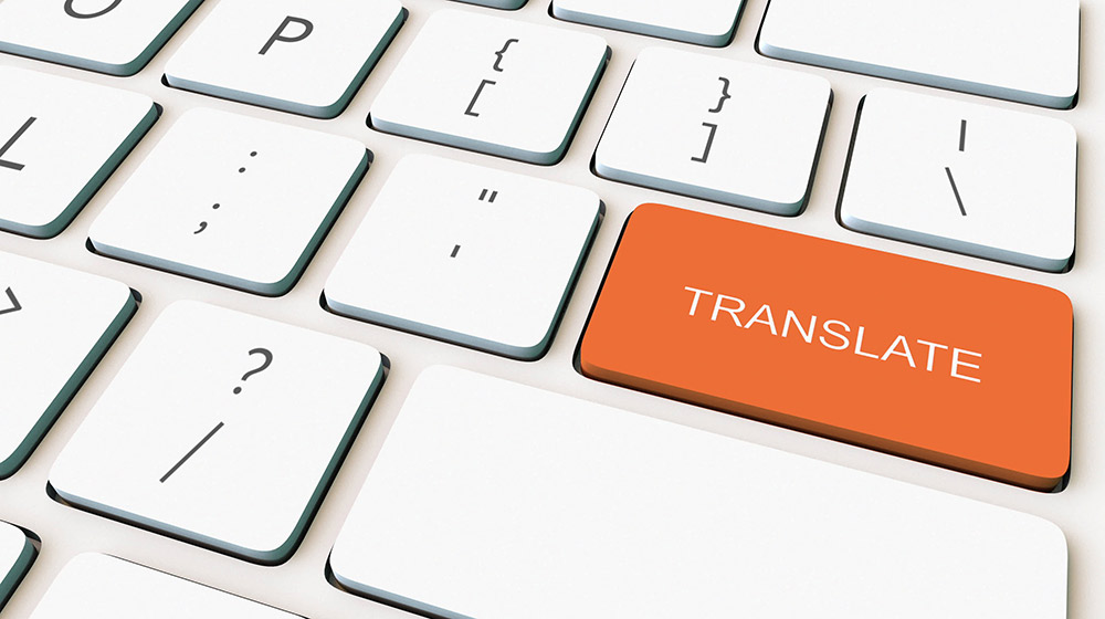 orange translate button highlighted on white keyboard | Feature Image | 5 Translation Tools to Help You Out